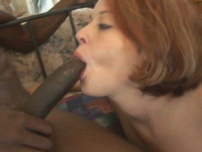Flat titted redhead Trisha Rey is fucking in a hardcore interracial sex video