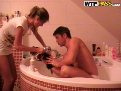 Couple of newlyweds wash their dog in Jacuzzi