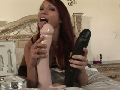 Professional bitch Nicki Hunter shows off her dildo collection