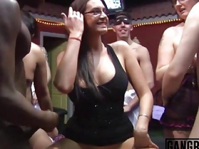 Hot brunette busty MILF with glasses enjoys in a steamy hardcore gangbang