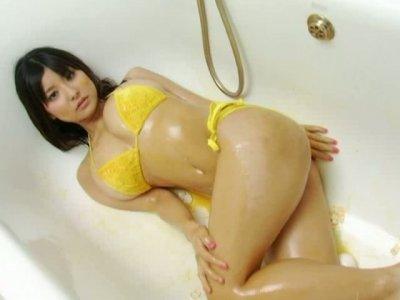 Weird nympho Miri Hanai covers her boobs with yolk