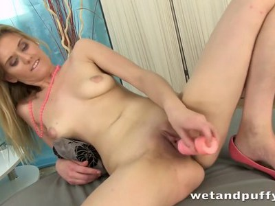 Petite blonde chick plays with a speculum