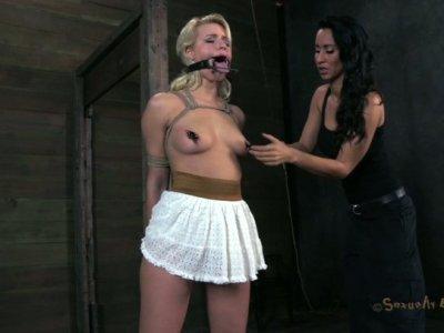 Pallid busty blondie Anikka Albrite gets tied up for BDSM session